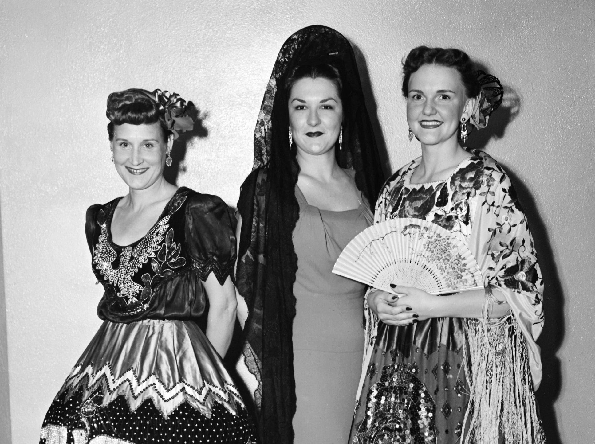 Fiesta finery was in fashion at Trinity Methodist Church in October 1951.  Among more than a score who dressed up to bring life to a study of Latin American missions were Mrs. W.K. Bradley (Left) of 1765 Crump; Mrs. Turner Morehead Jr. (Center) of 53 East Norwood and Mrs. Kenneth E. McRae Jr. of 2854 Spottswood.  Sponsor was the Woman's Society of Christian Service.