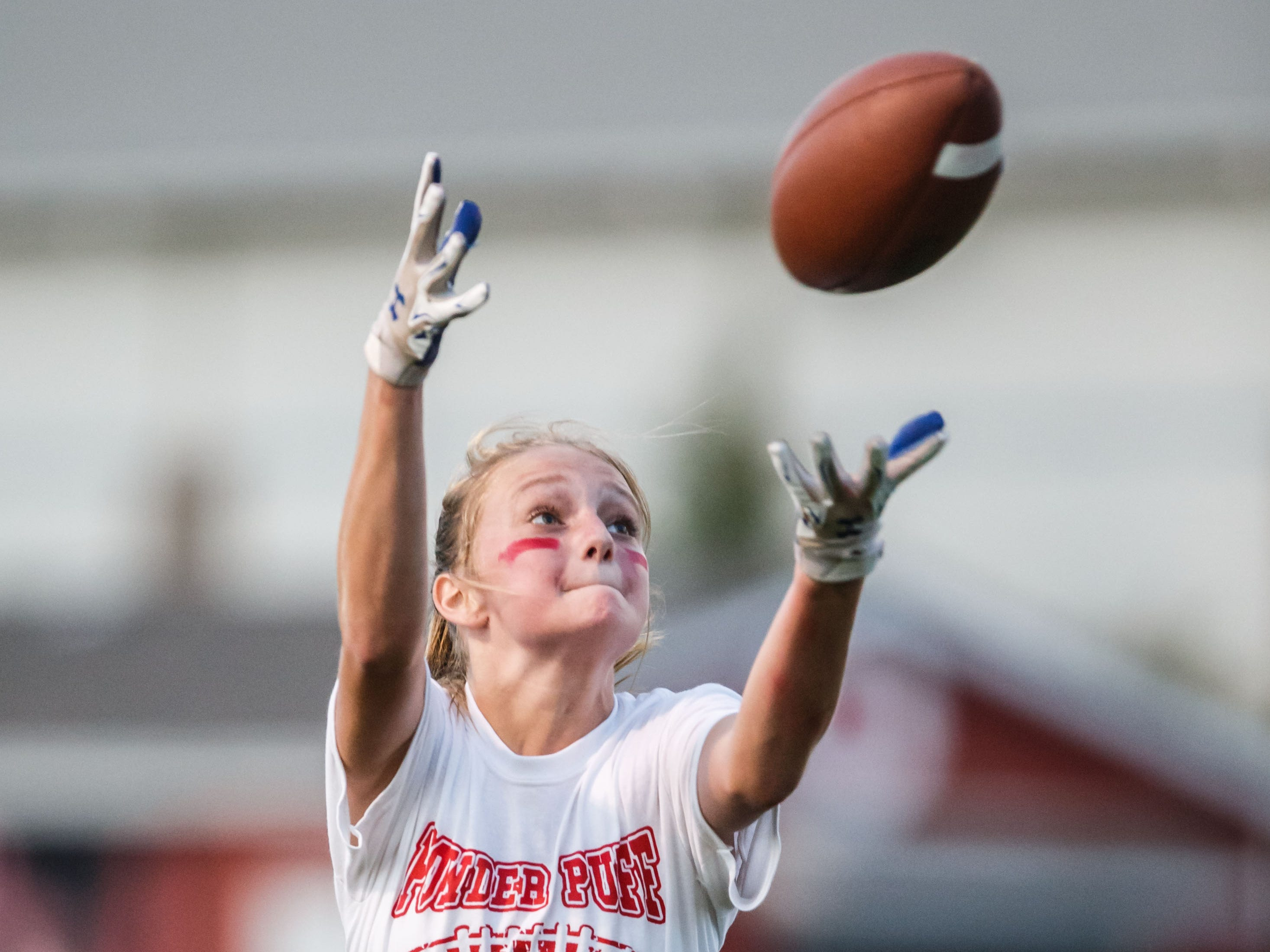 Hamilton freshman Isabelle Langkamp reaches for a pass during the freshman vs. seniors powder puff football game on Wednesday, Oct. 3, 2018. The game was part of the school's homecoming week celebrations.
