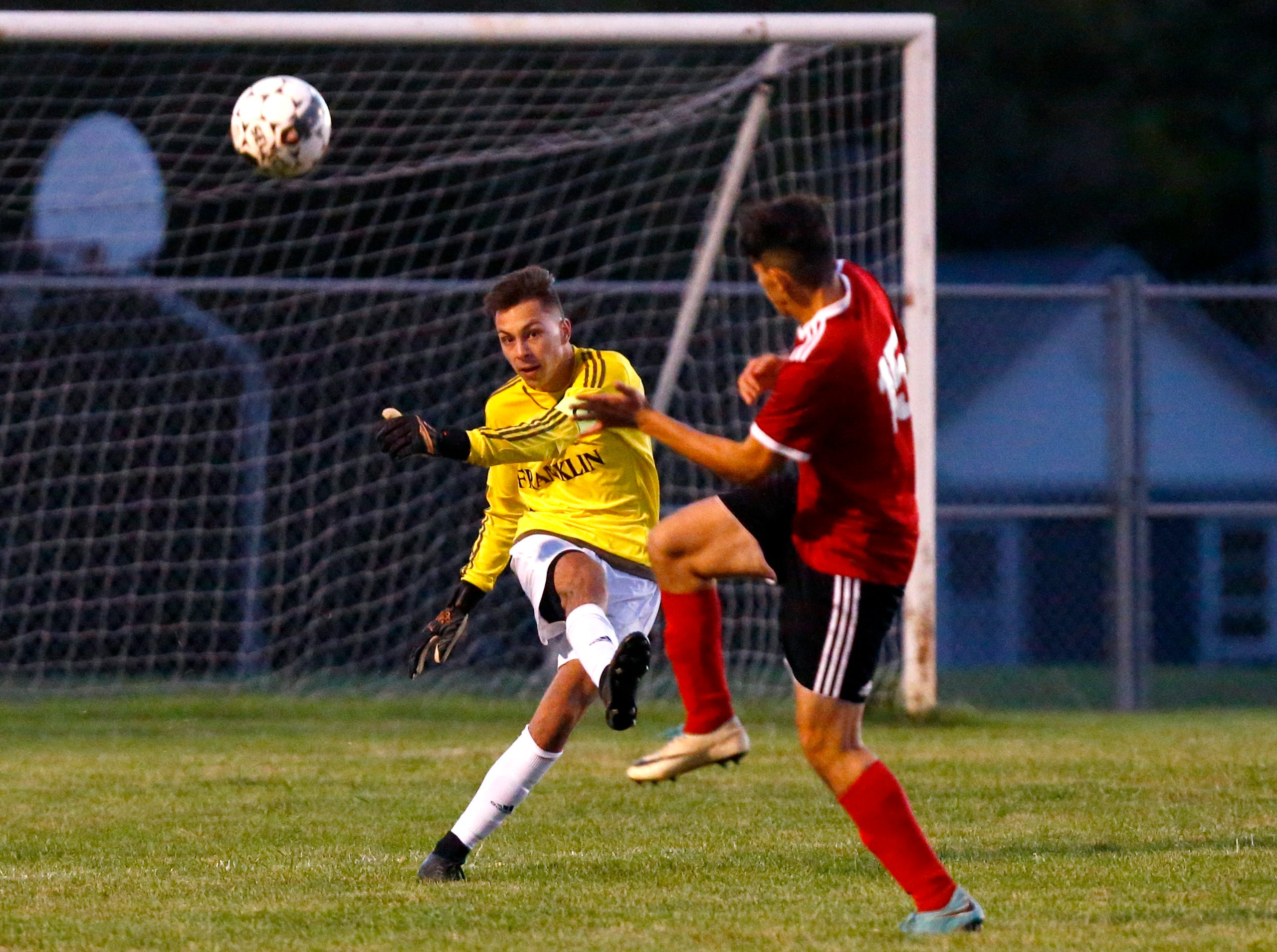 Franklin's Joe Heup sends the ball away from South Milwaukee's Watheq Al Maadheedi at South Milwaukee on Oct. 4.