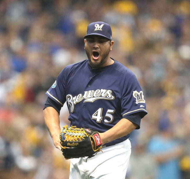 Brewers starting pitcher Jhoulys Chacin reacts after getting out of a slight jam against the Rockies in the first inning of Game 2 of the teams' NL Division Series on Friday at Miller Park.