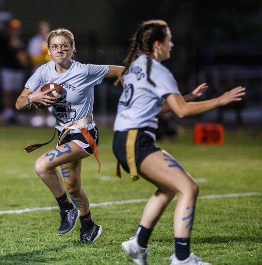 Hamilton junior Sarah Berg runs from the backfield during the sophomores vs. juniors powder puff football game on Oct. 3, 2018. We're looking for your 2019 homecoming photos. Use #jshoco19 in your photo posts on social media.