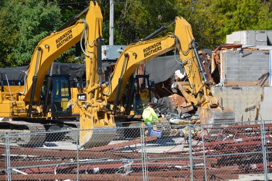 A pair of backhoes work through the rubble of the former Delafield Shopping Center in the 200 block of Delafield Street on Oct. 4. The demolition of the center, once home to Jendusa Pharmacy and other businesses, will make way for a new, as yet undetermined, development at the site.