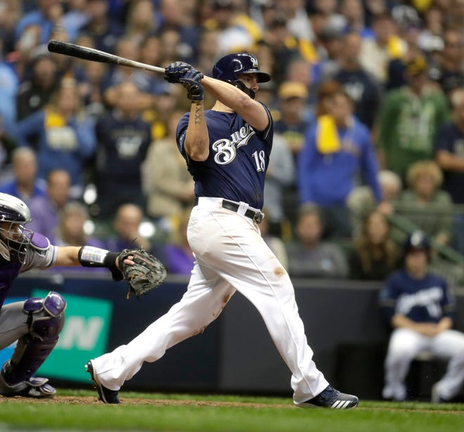 Mike Moustakas singles home Christian Yelich with two outs in the bottom of the 10th to rally Brewers past the Rockies in Game 1 of the teams' NL Division Series on Thursday at Miller Park.