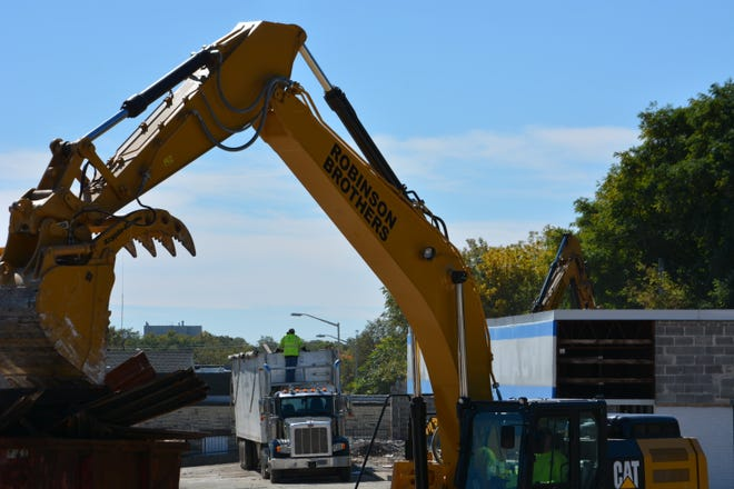 Demolition crews tear down the small strip mall once known as the Delafield Shopping Center, across from Waukesha City Hall, on Oct. 4. The city purchased the property in March with the intent of selling it to a private developer for a yet-unknown use.