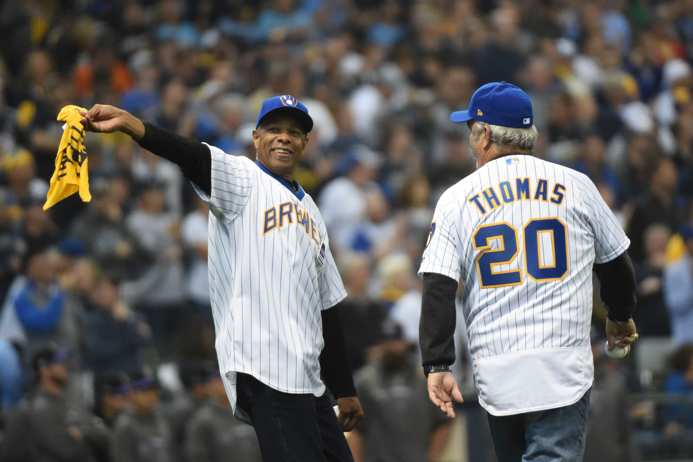 Former Brewers greats Cecil Cooper and Gorman Thomas head out toward the mound to throw out the ceremonial first pitch before Game 2 of the NL Division Series against Rockies on Friday at Miller Park.