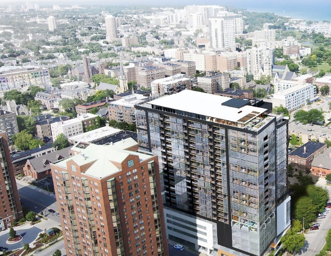 An unusual apartment high-rise developed with mass timber (right) could be appearing on downtown Milwaukee's skyline in 2021.