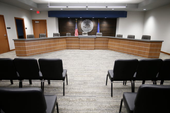 The village board and court room used wood from the room's old ceiling as a background to the board table and village seal.