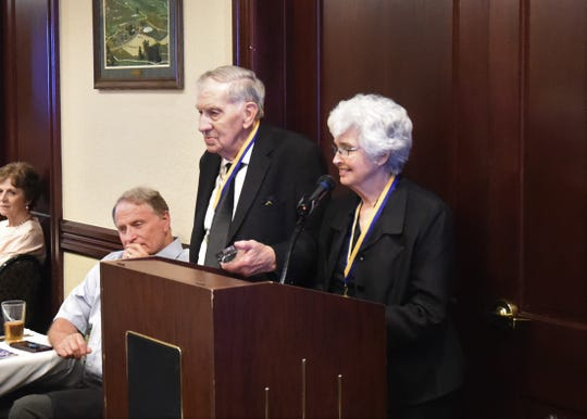 Norman and Margaret Norman stand at the podium to address the crowd Thursday night after being inducted into the Mountain Home Education Foundation Hall of Honor.