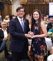 Arkansas State University-Mountain Home Chancellor Dr. Robin Myers (left) accepted ASU-MH's induction into the Mountain Home Education Foundation's Hall of Honor on Thursday night. Also pictured with Dr. Myers is Mountain Home High School Student Council President Ashlynn Martin.