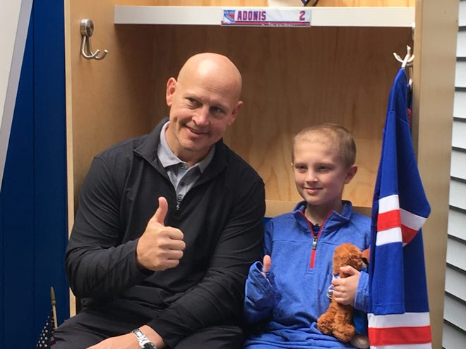 Former New York Rangers left wing Adam Graves helps Matt Adonis, an 11-year-old from Roxbury, celebrate his birthday.