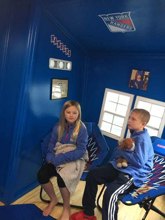 Mady and Matt Adonis try out their new Rangers-themed clubhouse.
