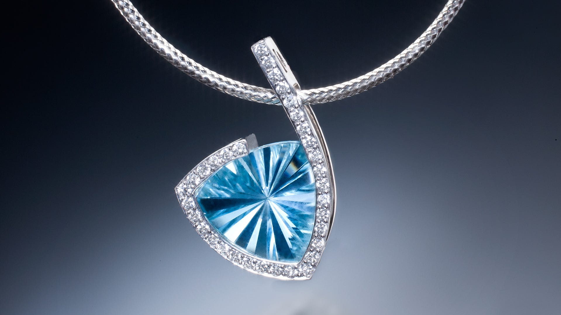 Fine crafts, such as this necklace with a pendant of aquamarine and diamonds, are on display at the Morristown Armory as part of the 42nd Annual Morristown CraftMarket.  The three-day craft and art fair includes a silent auction to raise money for the neonatal ICU at Morristown Memorial Hospital.