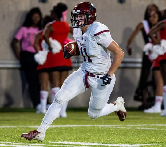 Prattville's Taylor Thompson (11) carries the ball against Lee in first half action at Cramton Bowl in Montgomery, Ala., on Thursday October 4, 2018.