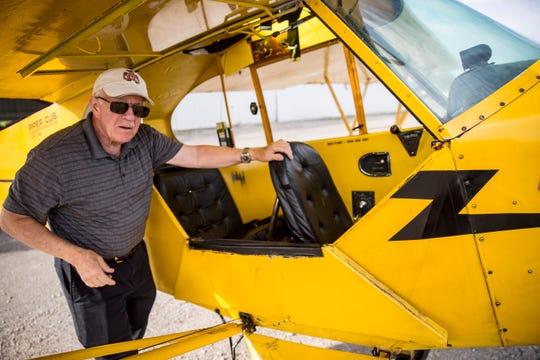 Steve Reese, who single-handedly runs the Reese Airport in Muncie pulls one of his planes out of the hangar during a tour of the small airstrip. The airport was started by his father and uncle.