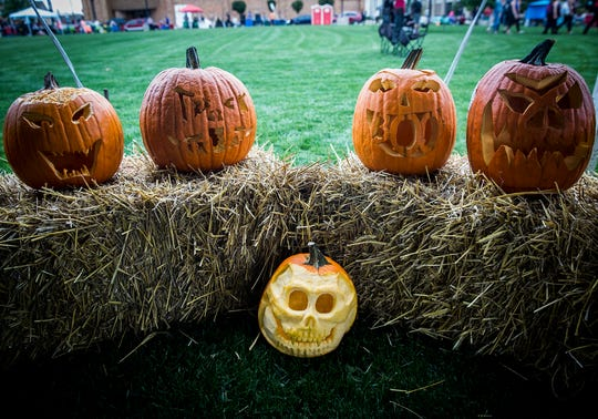 Carved jack o' lanterns are displayed at Canan Commons during the 2018 ArtsWalk. The Pumpkin Trail will be part of this year's ArtsWalk on Oct. 3, 2019.
