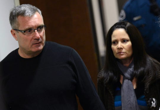 Thomas Teves, left, and his wife Caren Teves arrive for court, Tuesday, Jan. 8, 2012, on the second day of hearings for accused Aurora theater gunman James Holmes, in Centennial, Colo. The couple's 24-year-old son Alex was killed in the attack.