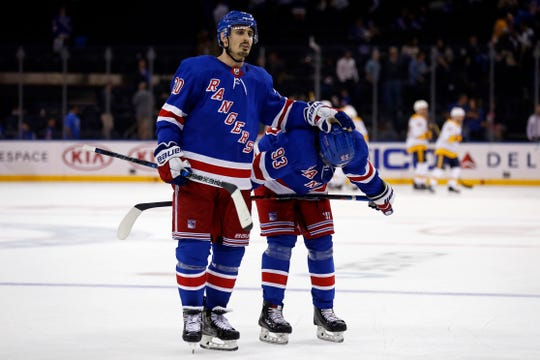 Oct 4, 2018; New York, NY, USA; New York Rangers left wing Chris Kreider (20) and Rangers center Mika Zibanejad (93) skate off the ice after losing to the Nashville Predators at Madison Square Garden.