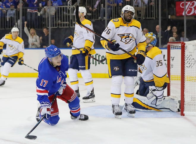 The Rangers' Jesper Fast (17) celebrates after scoring past Predators defenseman P.K. Subban (76) and goaltender Pekka Rinne on Oct. 4.