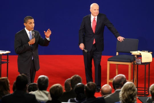 Barack Obama and John McCain participate in a town hall style presidential debate in the Curb Event Center at Belmont University in Nashville, Tenn., on Tuesday, October 7, 2008.