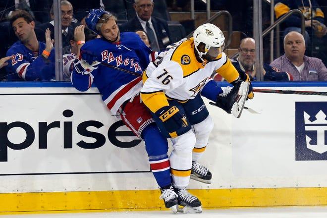 New York, NY, USA; Nashville Predators defenseman P.K. Subban (76) checks New York Rangers center Vladislav Namestnikov (90) during the first period at Madison Square Garden.