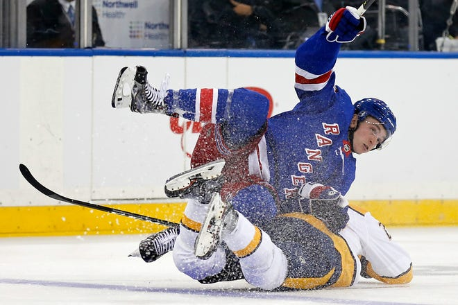 Oct 4, 2018; New York, NY, USA; New York Rangers left wing Jimmy Vesey (26) falls on top of Nashville Predators right wing Miikka Salomaki (20) during the second period at Madison Square Garden.