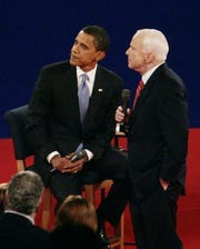 Barack Obama and John McCain debate at Belmont University in Nashville on Oct. 7, 2008.