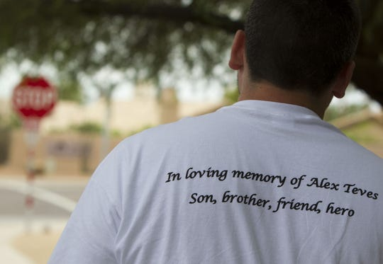 Friends and family attends  memorial service of Alex Teves at Corpus Christi Catholic Church in Ahwatukee, Az., on Saturday July 28, 2012.  Alex Teves was one of the victim killed in the horrific mass shooting in Aurora, Colo.