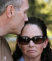 "Tom Teves kisses his wife, Caren Teves, as they speak about their son Alex Teves, at the Arapahoe County Courthouse, Monday, July 23, 2012, in Centennial, Colo. Alex Teves was one of the 12 people killed in the shooting attack early Friday at an Aurora, Colo., theater during a showing of the Batman movie, ""The Dark Knight Rises."""