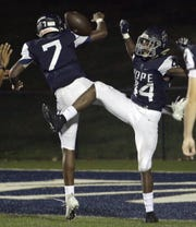 Pope John Paul II's Ben Nixon (left) and Antwan Roberts celebrate a TD against Hillwood on Thursday, October 4, 2018.