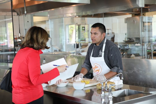 Lamoraga chef JC Perez talks to a 2017 Naples Foodie Camp participant.