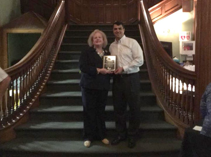 Mary Ellen Doster accepting award on behalf of Boiling Springs Savings Bank, Paul Galgano (Rebuilding Together North Jersey VP). Rebuilding Together North Jersey's 20th anniversary celebration honoring the junior league and boiling springs bank at the Hamilton club in Paterson. 09/27/2018