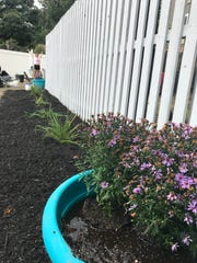 Lakeland Regional High School students joined teachers and Lowe's employees in a student-led cleanup and beautification project at the Strengthen Our Sisters women's shelter in Wanaque on Oct. 4, 2018. A smaller group of students spent two days in August painting the fences with supplies donated by Sherwin Williams in Oakland.