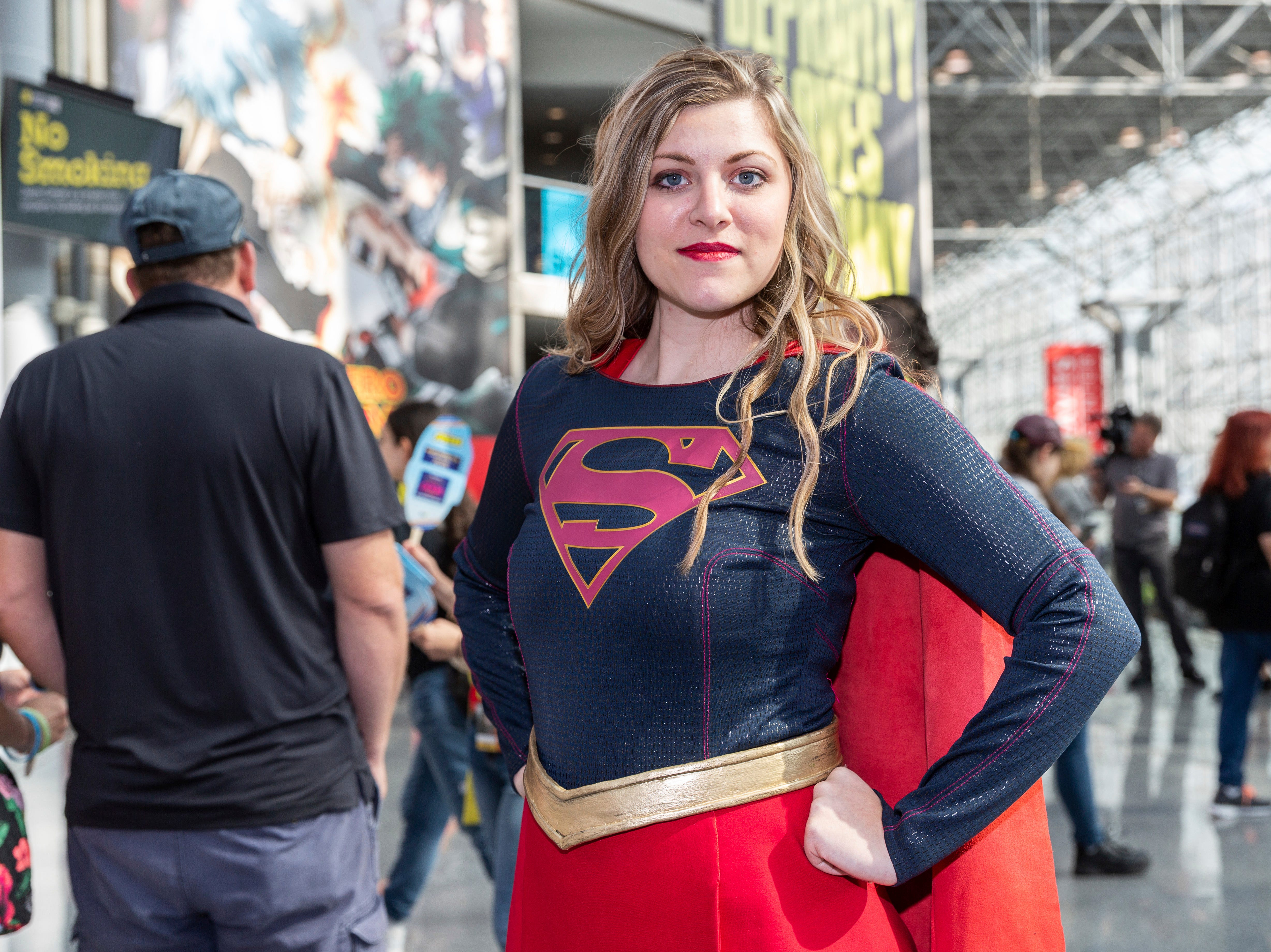 A fan dressed up as Supergirl poses for a photo during the first day of New York Comic Con, Thursday, Oct. 4, 2018. (AP Photo/Steve Luciano)