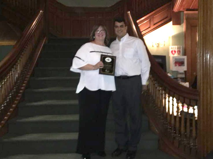 Leslie Martin Bazzino accepting award on behalf of the Junior League of Bergen County, Paul Galgano (Rebuilding Together North Jersey VP). Rebuilding Together North Jersey's 20th anniversary celebration honoring the junior league and boiling springs bank at the Hamilton club in Paterson. 09/27/2018
