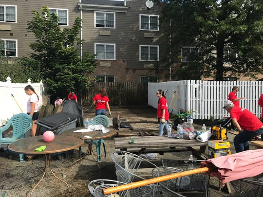 Lakeland Regional High School students joined teachers and Lowe's employees in a student-led cleanup and beautification project at the Strengthen Our Sisters women's shelter in Wanaque on Oct. 4, 2018.