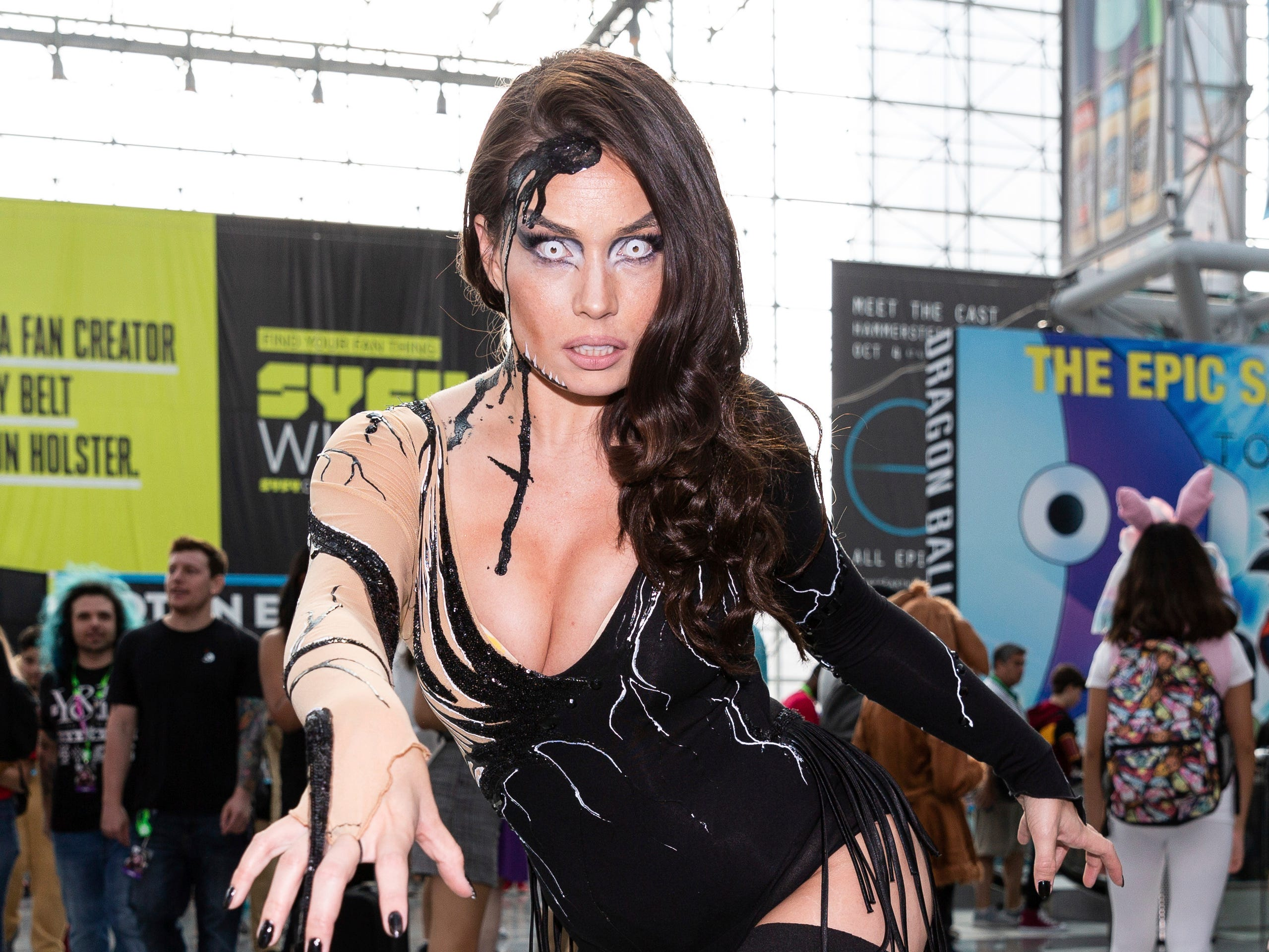 A fan dressed in costume poses for a photo during the first day of of New York Comic Con, Thursday, Oct. 4, 2018. (AP Photo/Steve Luciano)