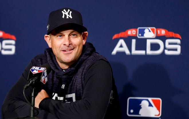 New York Yankees manager is Aaron Boone listens during a news conference before Game 1 of baseball's American League Division Series against the Boston Red Sox, Friday, Oct. 5, 2018, in Boston.