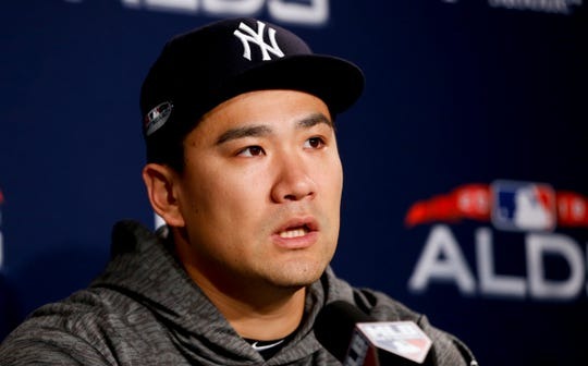 New York Yankees starting pitcher Masahiro Tanaka talks during a news conference before Game 1 of a baseball American League Division Series against the Boston Red Sox on Friday, Oct. 5, 2018, in Boston.