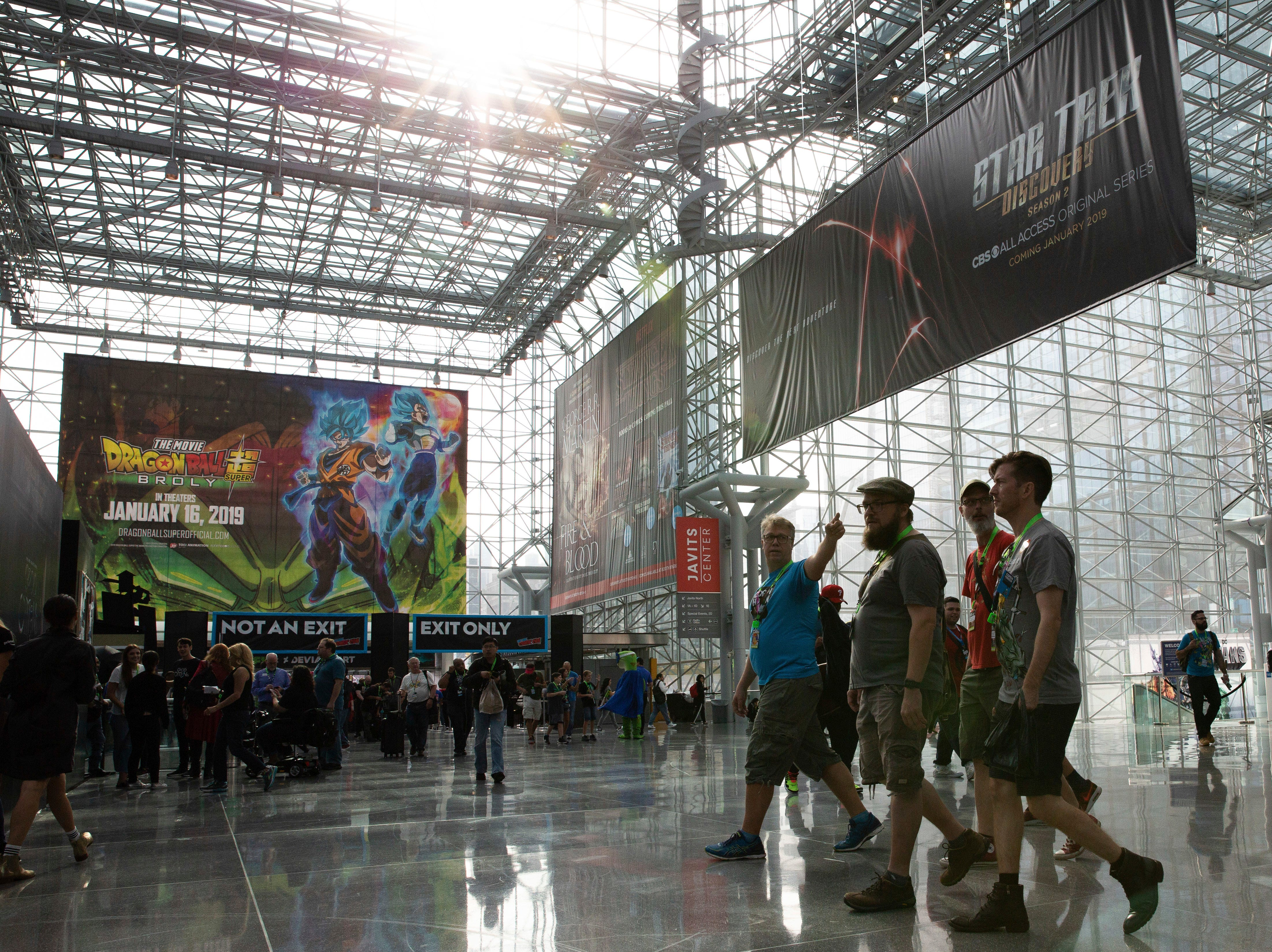 Attendees walk through the Javits Center during the first day of New York Comic Con, Thursday, Oct. 4, 2018. (AP Photo/Steve Luciano)