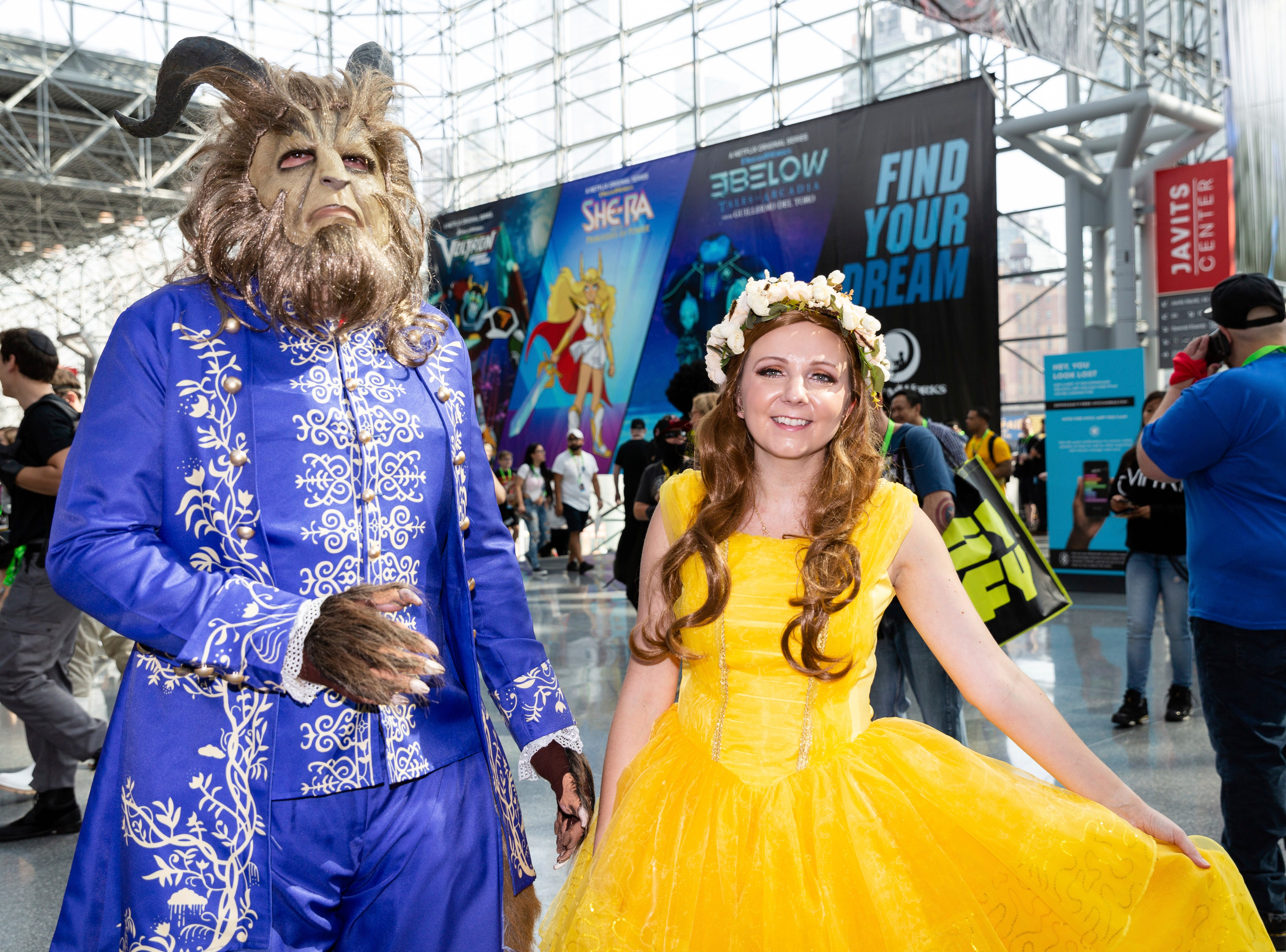 Fans dressed up as characters from Disney's Beauty and the Beast pose for a photo during the first day of New York Comic Con, Thursday, Oct. 4, 2018. (AP Photo/Steve Luciano)