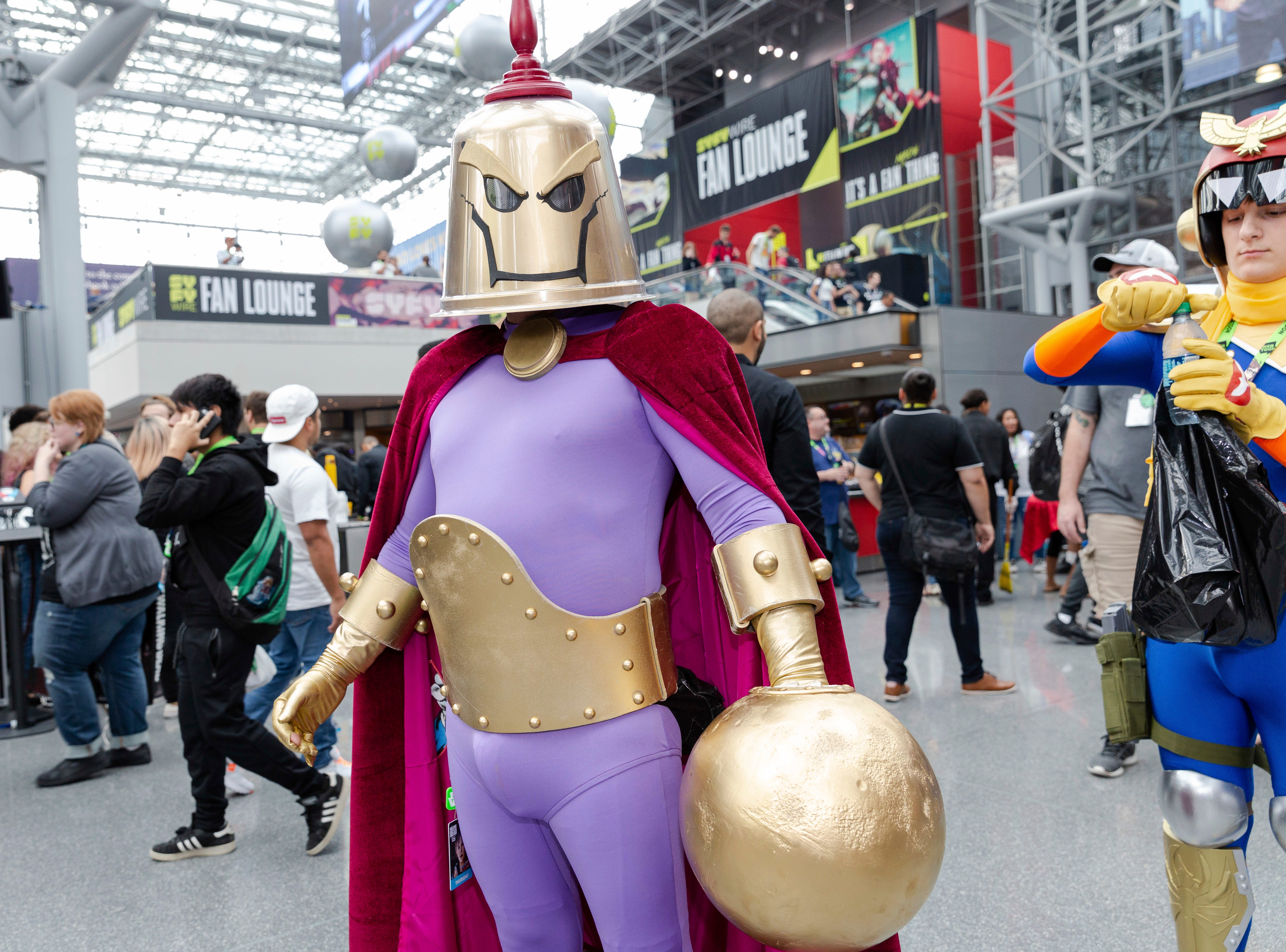 An attendee dressed in costume poses for a photo during the first day of New York Comic Con, Thursday, Oct. 4, 2018. (AP Photo/Steve Luciano)