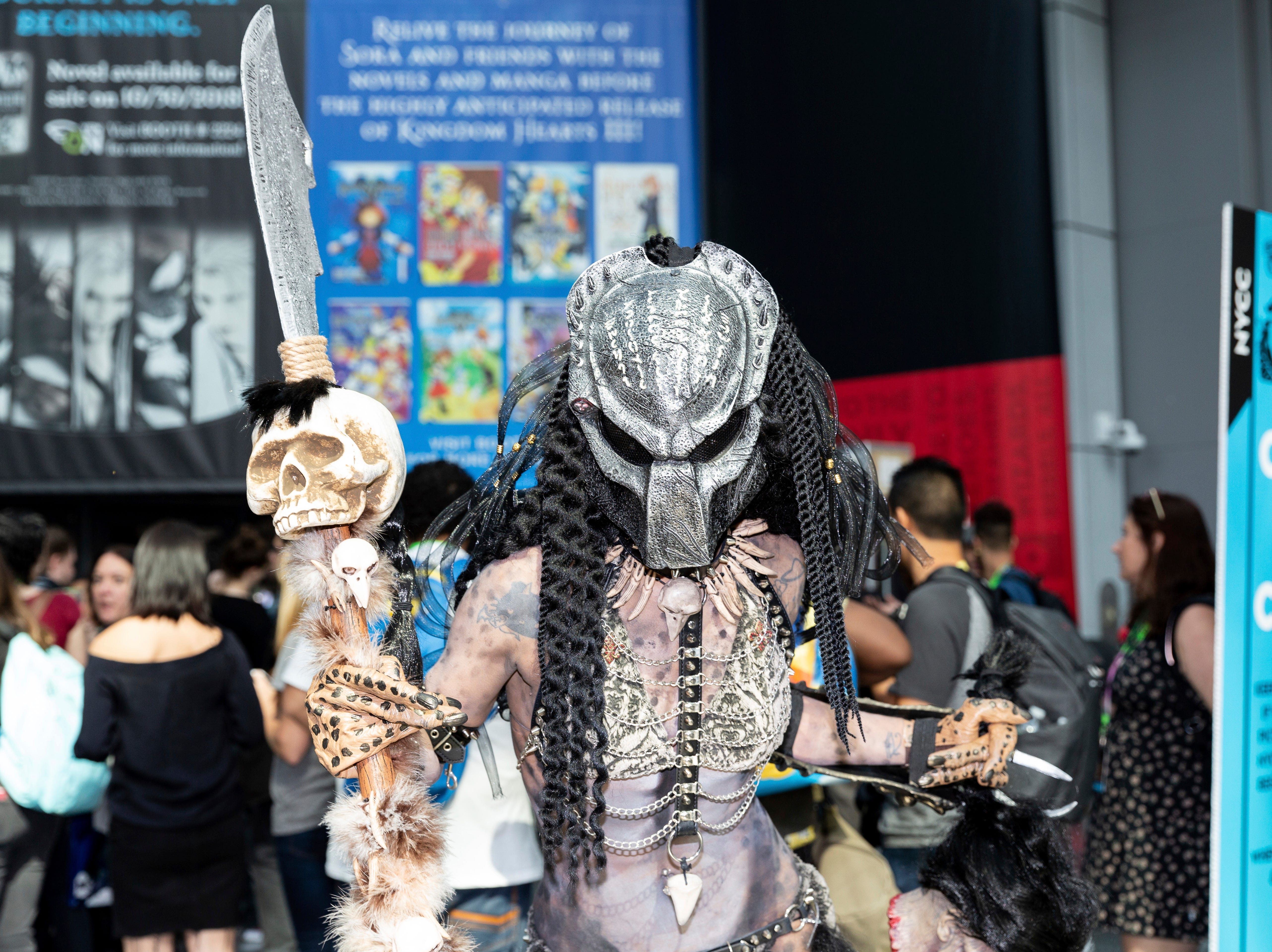 A fan dressed in costume poses for a photo during the first day of New York Comic Con, Thursday, Oct. 4, 2018. (AP Photo/Steve Luciano)