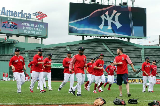 Boston Red Sox players warm up during a baseball workout at Fenway Park, Thursday, Oct. 4, 2018, in Boston, in preparation for Game 1 of the ALDS against the New York Yankees on Friday.
