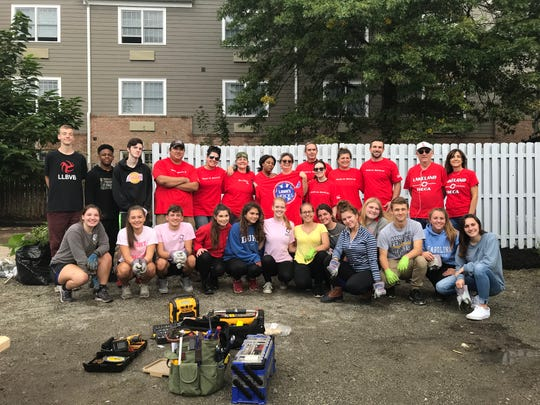 Lakeland Regional High School students joined teachers and Lowe's employees in a student-led cleanup and beautification project at the Strengthen Our Sisters women's shelter in Wanaque on Oct. 4, 2018. The three students in the bottom center row, Sarah Panicucci (blue sweatshirt), Liz Maciorowski (pink shirt) and Victoria Czaczkowski (yellow shirt) were the project leaders.