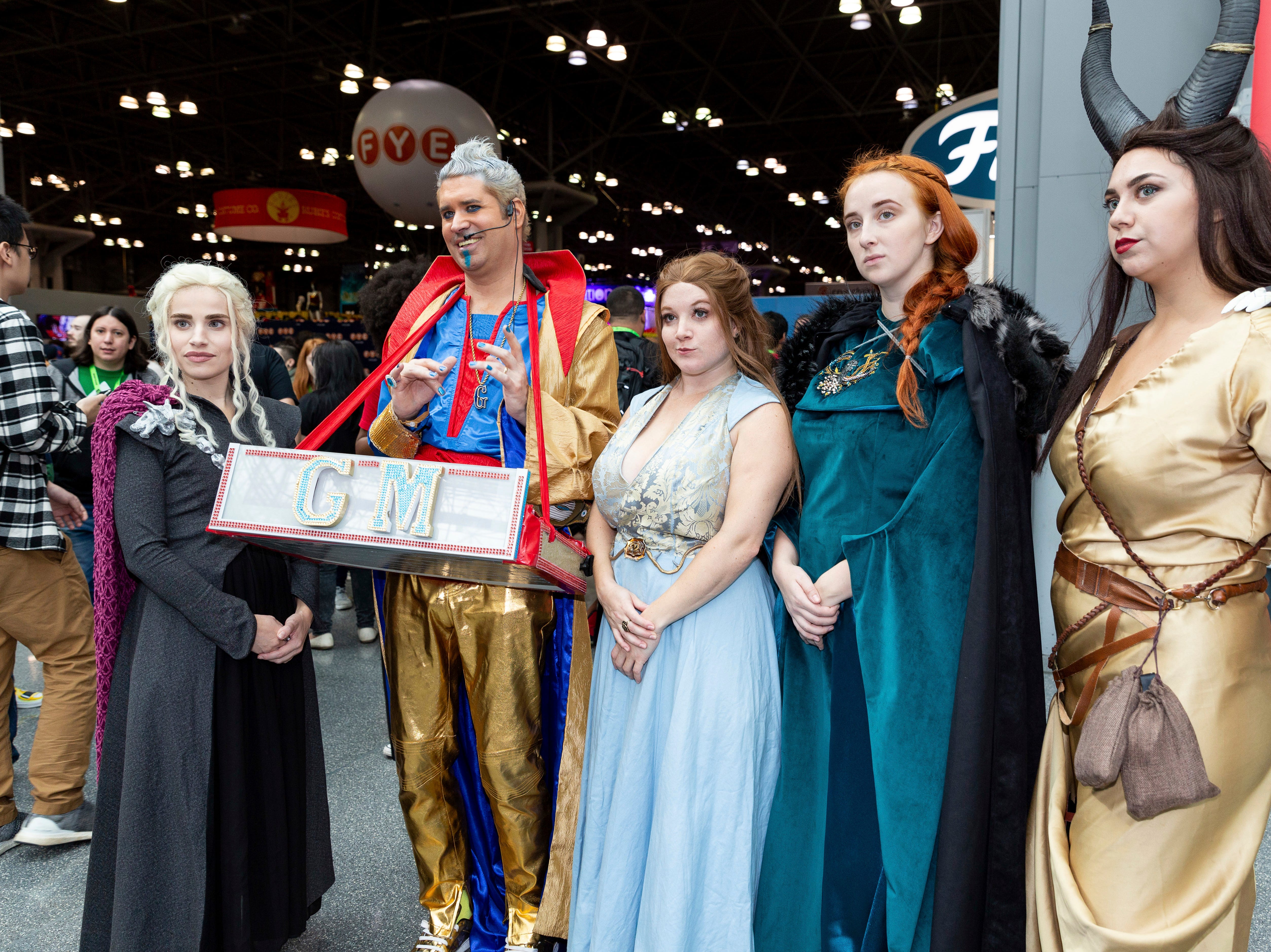 Attendees dressed in costume pose for a photo during the first day of New York Comic Con, Thursday, Oct. 4, 2018. (AP Photo/Steve Luciano)