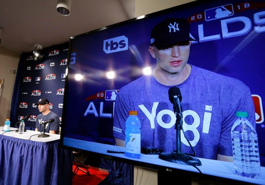 New York Yankees starting pitcher J.A. Happ is seen on a large screen as he speaks to repoters at Fenway Park, Thursday, Oct. 4, 2018, in Boston. The Yankees are scheduled to face the Boston Red Sox in Game 1 of a baseball AL Division Series on Friday.