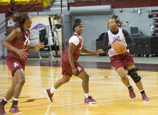 Rodrea Echols, right, runs drills with Adrianna Henderson, center, Nana Sule, right, at New Mexico State women's basketball practice on Thursday at the Pan American Center.
