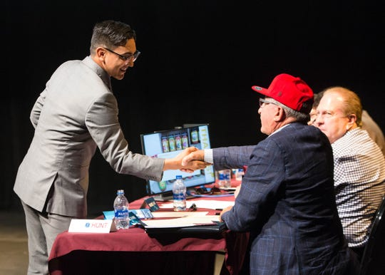 Patrick Montelongo shakes hands with Lou Sisbarro during the Aggie Shark Tank, Thursday October 4, 2018. Sisbarro agreed to a 10 percent stake in Montelongo's company, Pure New Mexico — a subscription service for local products. Montelongo also was awarded the crowd favorite and won $1,000.
