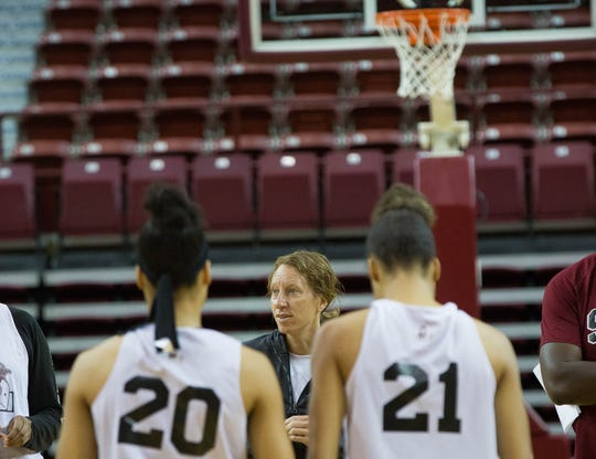 New Mexico State coach Brooke Atkinson speaks to her team on Thursday at the Pan American Center.