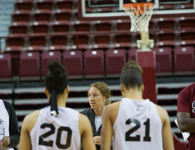 New Mexico State women's basketball coach Brooke Atkinson speaks to her team during practice last week.